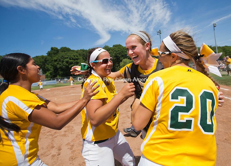 West Haven, CT- 13 June 2015-061315CM16-   Holy Cross' Gabby Goldman, left, Sarah Lawton, center, catcher Paige Hine, right and Elizabeth Lombardo #20 celebrate following a 4-0 win over Thomaston to capture the Class S state softball title in West Haven on Saturday.  Christopher Massa Republican-American