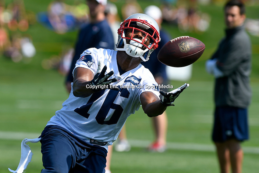 July 25, 2014 - Foxborough, Massachusetts, U.S.- new England Patriots wide receiver Greg Orton (16) reaches out to make a catch during the New England Patriots training camp held at Gillette Stadium in Foxborough Massachusetts.  Eric Canha/CSM