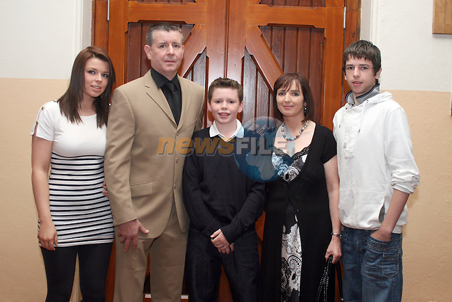 Cormac Hughes and family at the confirmation in Termonfeckin Church...Photo NEWSFILE/Jenny Matthews.(Photo credit should read Jenny Matthews/NEWSFILE)....This Picture has been sent you under the condtions enclosed by:.Newsfile Ltd..The Studio,.Millmount Abbey,.Drogheda,.Co Meath..Ireland..Tel: +353(0)41-9871240.Fax: +353(0)41-9871260.GSM: +353(0)86-2500958.email: pictures@newsfile.ie.www.newsfile.ie.FTP: 193.120.102.198.