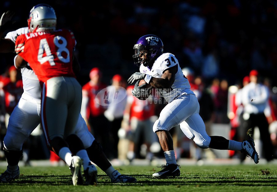 Nov. 27, 2010; Albuquerque, NM, USA; TCU Horned Frogs tailback (34) Ed Wesley runs the ball in the first half against the New Mexico Lobos at University Stadium. TCU defeated New Mexico 66-17 to finish the season undefeated. Mandatory Credit: Mark J. Rebilas-