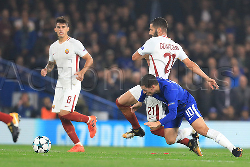 18th October 2017, Stamford Bridge, London, England; UEFA Champions League, Maxime Gonalons of Roma fouls Eden Hazard of Chelsea