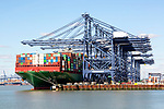 CSCL Pacific Ocean container ship and cranes at dockside, Port of Felixstowe, Suffolk, England, UK