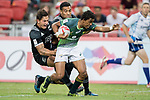 Tim Agaba of South Africa runs with the ball while New Zealand's players try to stop him during the match South Africa vs New Zealand, Day 2 of the HSBC Singapore Rugby Sevens as part of the World Rugby HSBC World Rugby Sevens Series 2016-17 at the National Stadium on 16 April 2017 in Singapore. Photo by Victor Fraile / Power Sport Images