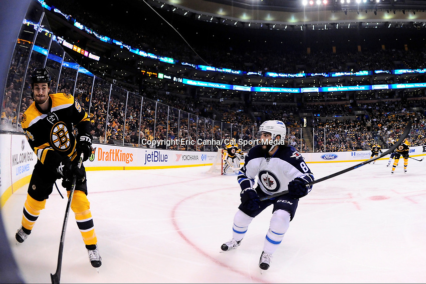 Thursday, October 8, 2015: Boston Bruins defenseman Adam McQuaid (54) works to get the puck out of his defensive zone as Winnipeg Jets center Mathieu Perreault (85) watches during the NHL game between the Winnipeg Jets and the Boston Bruins held at TD Garden, in Boston, Massachusetts. Winnipeg defeated Boston 6-2 in regulation time. Eric Canha/CSM