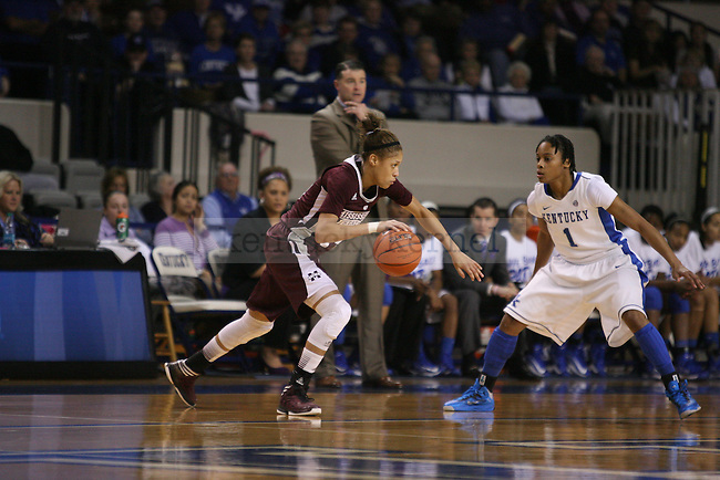 UK senior guard A'dia Mathies tracks Mississippi State sophomore guard Kendra Grant at Memorial Coliseum on Thursday, January 17, 2013 in Lexington, Ky.  Photo by Adam Pennavaria | Staff
