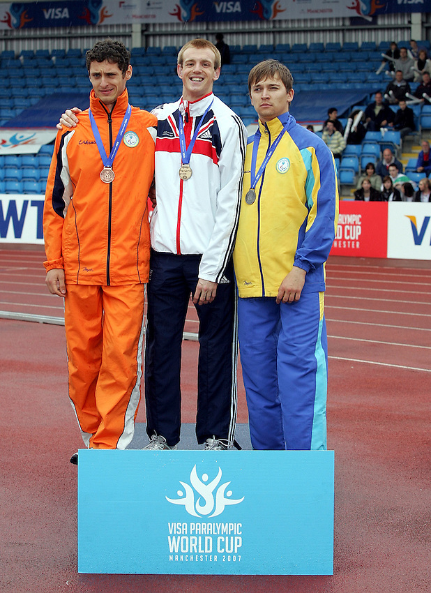 Photo: Paul Thomas..VISA Paralympic World Cup 2007. Athletics. 13/05/2007. .(lt to rt) Roman Pavlyk of Ukraine, Ben Rushgrove of Great Britain and Audrey Zhyltsov with their medals in the men's T36 200m.
