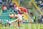 Aidan O'Neill of Dingle makes the break as Mitchels' Cathal O'Sullivan crashes to the floor.   Copyright Kerry's Eye 2008