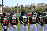 The Miami Marlins during the singing of the Star Spangled Banner at a Grapefruit League Spring Training game at the Roger Dean Complex on March 4, 2014 in Jupiter, Florida. Miami defeated Minnesota 3-1. (Stacy Jo Grant/Four Seam Images)
