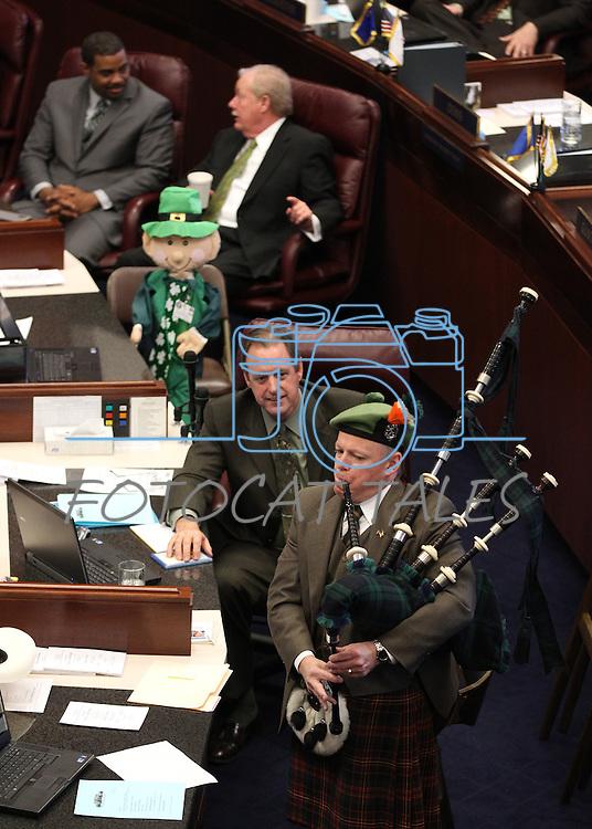 Former Nevada Senator Dennis Nolan plays the bagpips on the Senate floor at the Legislature in Carson City, Nev., on Thursday, March 17, 2011..Photo by Cathleen Allison