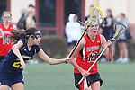Santa Barbara, CA 02/18/12 - Kelly Arnhart (Georgia #19) and Melissa Oddo (Michigan #20) in action during the Georgia-Michigan matchup at the 2012 Santa Barbara Shootout.  Georgia defeated Michigan 12-10.