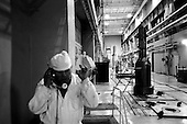 Dimitrovgrad, Russia  .May-June 1997.In the Scientific Research Institute of Nuclear Reactors containers of nuclear products are monitored by workers. The containers look like small space ships..