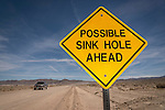 Possible Sink Hole Ahead traffic warning sign along the road, Nev.