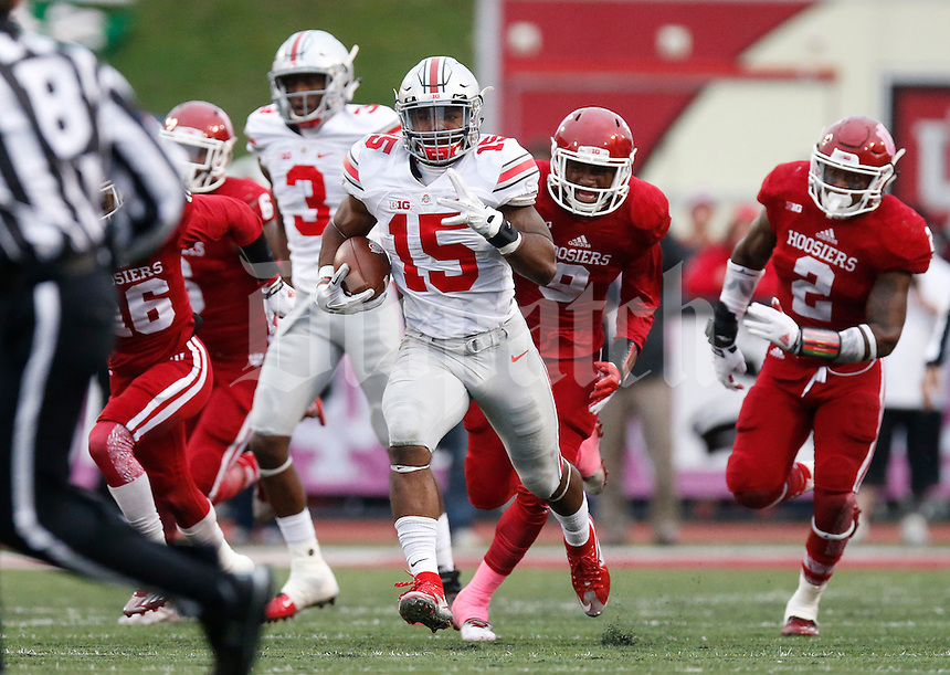 Ohio State Buckeyes running back Ezekiel Elliott (15) heads for the end  zone  to score a touchdown in the 4th quarter  an NCAA football game between the Ohio State Buckeyes and the Indiana Hoosiers at Memorial Stadium in Bloomington, Indiana, on Saturday, October 3, 2015. (Columbus Dispatch photo by Fred Squillante)   in the first half of an NCAA football game between the Ohio State Buckeyes and the Indiana Hoosiers at Memorial Stadium in Bloomington, Indiana, on Saturday, October 3, 2015. (Columbus Dispatch photo by Fred Squillante)