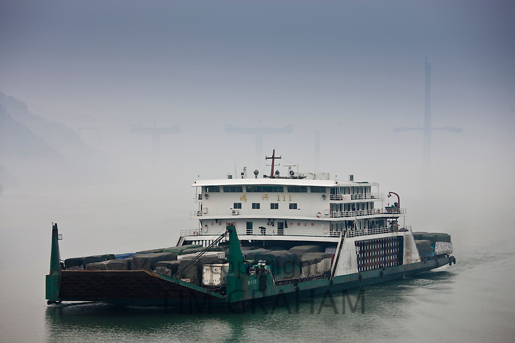 Transportation of trucks with freight and cargo, by boat on Yangtze River, China