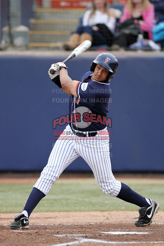 Carlos Lopez #17 of the Cal. St. Fullerton Titans bats against the Cal. St. Long Beach 49'ers at Goodwin Field in Fullerton,California on May 14, 2011. Photo by Larry Goren/Four Seam Images