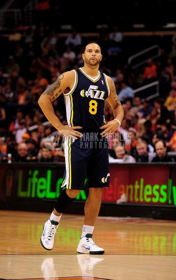 Oct. 12, 2010; Phoenix, AZ, USA; Utah Jazz guard (8) Deron Williams against the Phoenix Suns during a preseason game at the US Airways Center. Mandatory Credit: Mark J. Rebilas-