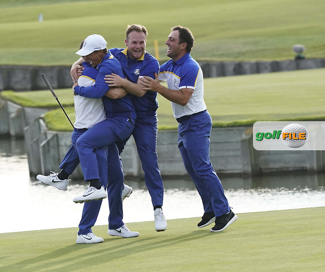 Alex Noran (Team Europe) Rory McIlroy (Team Europe) Tyrrell Hatton (Team Europe) and Francesco Molinari (Team Europe) celebrate at the Ryder Cup, Le Golf National, Iles-de-France, France. 30/09/2018.<br /> Picture Claudio Scaccini / Golffile.ie<br /> <br /> All photo usage must carry mandatory copyright credit (© Golffile | Claudio Scaccini)