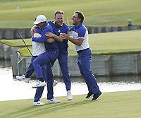 Alex Noran (Team Europe) Rory McIlroy (Team Europe) Tyrrell Hatton (Team Europe) and Francesco Molinari (Team Europe) celebrate at the Ryder Cup, Le Golf National, Iles-de-France, France. 30/09/2018.<br /> Picture Claudio Scaccini / Golffile.ie<br /> <br /> All photo usage must carry mandatory copyright credit (&copy; Golffile | Claudio Scaccini)
