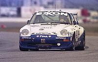 The #41 Porshe 911 Carerra RSR of Kurt Thiers, Michel Neugarten, Franco La Rosa, and Kurt Dujardyn races to a 10th place finish in the 24 Hours of Daytona, IMSA race, Daytona International Speedway, Daytona Beach , FL, February 4, 1996.  (Photo by Brian Cleary/www.bcpix.com)