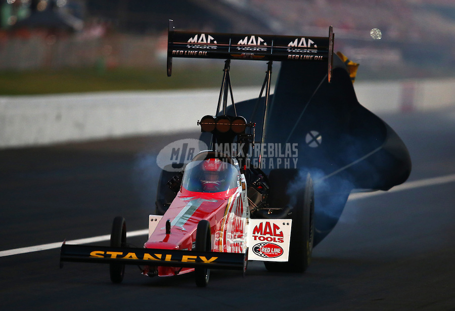 Aug. 30, 2013; Clermont, IN, USA: NHRA top fuel dragster driver Doug Kalitta during qualifying for the US Nationals at Lucas Oil Raceway. Mandatory Credit: Mark J. Rebilas-