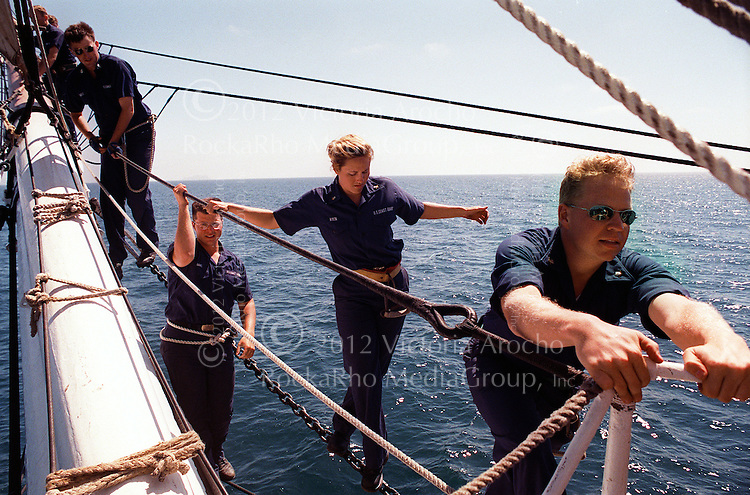 U.S. Coast Guard Cadets walk from the bow of the U.S.S. Coast Guard Eagle training vessel, August 11, 1999 on the Pacific waters along the coast of San Diego. The Eagle a three-masted sailing Barque with 21,350 square feet of sail is home to Coast Guard Academy Cadets for a week the summer prior to attending the Academy. (AP Photo/ Victoria Arocho)
