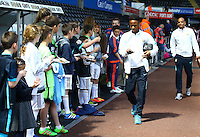 Raheem Sterling of Manchester City on his phone as he arrives before the Barclays Premier League match between Swansea City and Manchester City played at The Liberty Stadium, Swansea on 15th May 2016