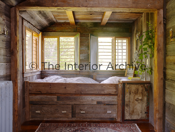 This box bed in one of the children's rooms has been constructed from recycled wood