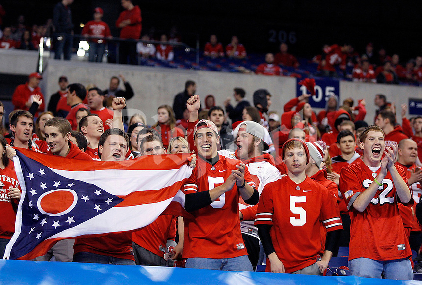 Ohio State fans get excited as the band plays prior to the Big Ten Championship football game at Lucas Oil Stadium in Indianapolis on Friday, December 7, 2013. (Columbus Dispatch photo by Jonathan Quilter)