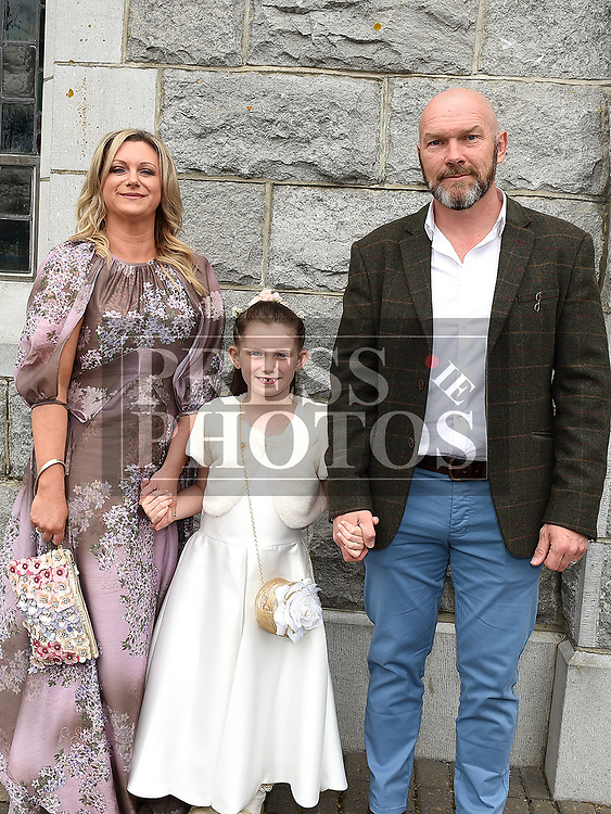 May Darcy who received first holy communion in St. Cianan's church Duleek pictured with parents Brian and Ruth.  Photo:Colin Bell/pressphotos.ie