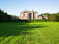 An 18th century country house occupies over 20 acres of gardens and woodland along the Scottish coastline