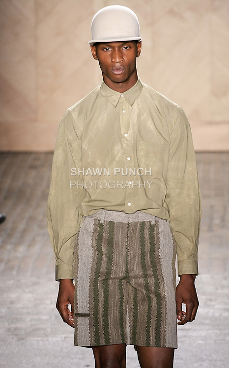 Adonis Bosso walks runway in an outfit from the Perry Ellis by Duckie Brown Spring Summer 2013 collection, during New York Fashion Week Spring 2013.
