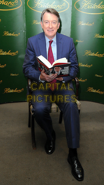 """LORD PETER MANDELSON Booksigning session for his new book """"The Third Man Life At The Heart of New Labour"""", Hatchards, Piccadilly, London, England. .July 15th, 2010 .full length suit jacket blue red tie sitting chair .CAP/WIZ.© Wizard/Capital Pictures."""