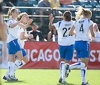 Boston's Kelley Smith, left,  is congratulated after scoring a goal. FC Gold Pride defeated the Boston Breakers 2-1 at Buck Shaw Stadium in Santa Clara, California on April 5th, 2009.