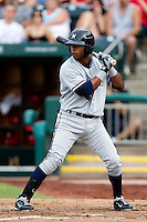 Rey Navarro (8) of the Northwest Arkansas Naturals at bat during a game against the Springfield Cardinals and the Springfield Cardinals at Hammons Field on July 30, 2011 in Springfield, Missouri. Springfield defeated Northwest Arkansas 11-5. (David Welker / Four Seam Images)