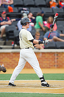Conor Keniry (14) of the Wake Forest Demon Deacons at bat against the Virginia Cavaliers at Wake Forest Baseball Park on May 17, 2014 in Winston-Salem, North Carolina.  The Demon Deacons defeated the Cavaliers 4-3.  (Brian Westerholt/Four Seam Images)