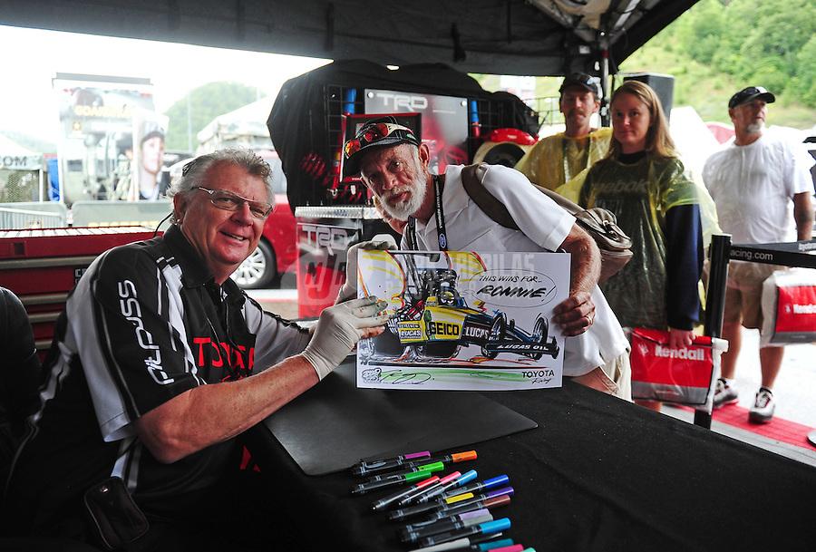 Jun. 19, 2011; Bristol, TN, USA: NHRA artist Kenny Youngblood signs autographs at the Thunder Valley Nationals at Bristol Dragway. Mandatory Credit: Mark J. Rebilas-US