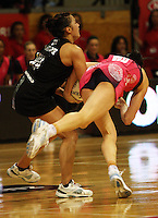 NZ's Liana Barrett-Chase wrestles for the ball with Peta Scholz during the International  Netball Series match between the NZ Silver Ferns and World 7 at TSB Bank Arena, Wellington, New Zealand on Monday, 24 August 2009. Photo: Dave Lintott / lintottphoto.co.nz
