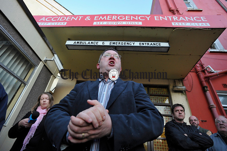 Chairman of the Ennis Hospital action committee, Ciaran O Dea addresses the protestors gathered at the entrance of the A&E while on a vigil to protest against the closure of 24-hour A&E services at Ennis Hospital on Monday night.  Photograph by John Kelly.