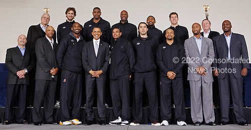 United States President Barack Obama (Bottom row 4L)) poses for photographs with members of the 2010 NBA Championship Los Angeles Lakers during an event at the Boys and Girls Club at THEARC, December 13, 2010 in Washington, DC. The Lakers team volunteered on projects at the club before being honored by the president for their victory.  (Photo by Chip Somodevilla/Getty Images).Credit: Chip Somodevilla - Pool via CNP