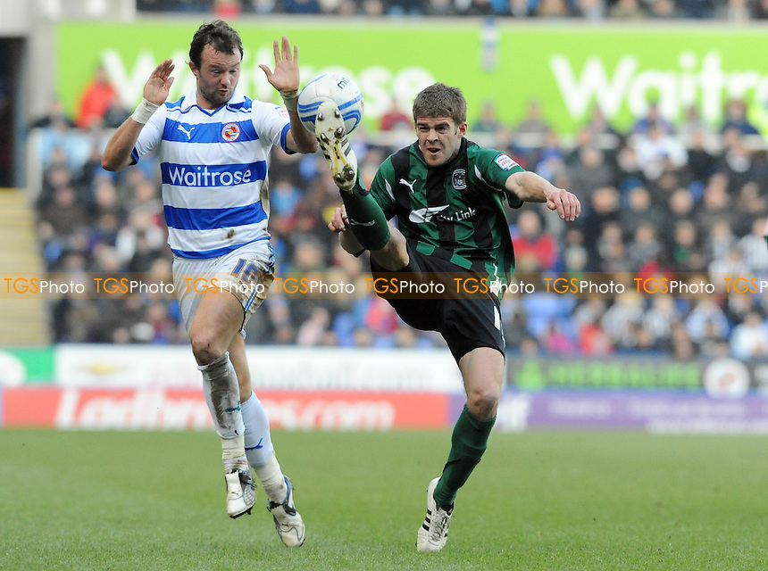Martin Cranie of Coventry clears as Noel Hunt of Reading takes evasive action - Reading vs Coventry City - nPower League Championship Football at the Madejski Stadium - 11/02/12 - MANDATORY CREDIT: Anne-Marie Sanderson/TGSPHOTO - Self billing applies where appropriate - 0845 094 6026 - contact@tgsphoto.co.uk - NO UNPAID USE.