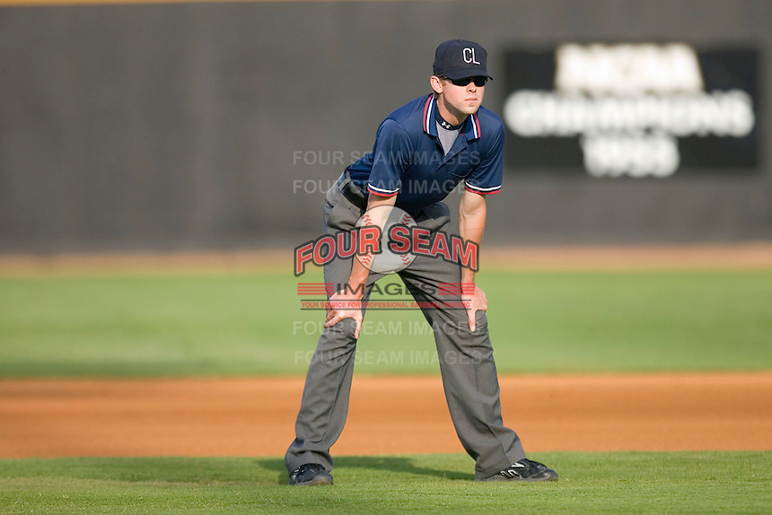 Umpire Kolin Kline handles the calls on the bases during a Carolina League game between the Lynchburg Hillcats and the Winston-Salem Dash at Wake Forest Baseball Stadium August 30, 2009 in Winston-Salem, North Carolina. (Photo by Brian Westerholt / Four Seam Images)