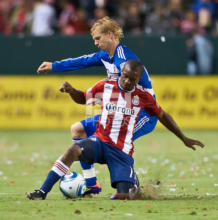 CARSON, CA – June 18, 2011: Chivas USA defender Michael Lahoud (11) and FC Dallas midfielder Brek Shea (20) during the match between Chivas USA and FC Dallas at the Home Depot Center in Carson, California. Final score Chivas USA 1, FC Dallas 2.