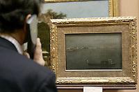 """Un turista osserva il dipinto """"Gondole sulla Laguna"""" di Francesco Guardi, nel Museo Poldio Pezzoli a Milano.<br /> A tourist admires the """"Gray Lagoon"""" painting by Francesco Guardi in the Museo Poldi Pezzoli in Milan.<br /> UPDATE IMAGES PRESS/Riccardo De Luca"""