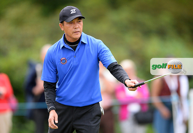 Lianwei Zhang of China reacts during the First Round of The Senior Open at Sunningdale Golf Club, Sunningdale, England. Picture: Golffile | Richard Martin-Roberts<br /> All photo usage must carry mandatory copyright credit (&copy; Golffile | Richard Martin- Roberts)