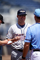 Lakeland Flying Tigers manager Andrew Graham (17) meets with the umpires before a game against the Charlotte Stone Crabs on April 16, 2017 at Charlotte Sports Park in Port Charlotte, Florida.  Lakeland defeated Charlotte 4-2.  (Mike Janes/Four Seam Images)