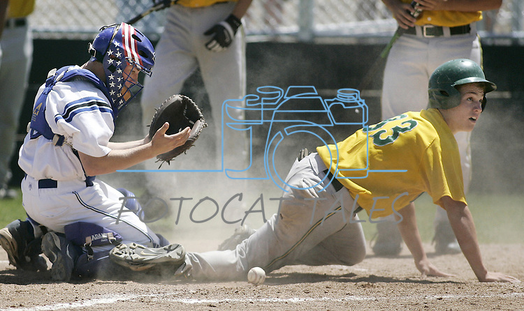 Manogue runner Timothy Lewis knocks the ball loose from Carson catcher Brooks Greenlee in a game May 9, 2006 in Reno, Nev..Photo by Cathleen Allison/Copyright Nevada Appeal