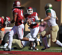 NWA Media/Michael Woods --10/25/2014-- w @NWAMICHAELW...University of Arkansas quarterback Brandon Allen scrambles out of the pocket as he looks for an open receiver in the UAB defense during the 1st quarter of Saturday's game at Razorback Stadium in Fayetteville.