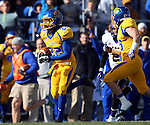 BROOKINGS, SD - OCTOBER 26:  Je Ryan Butler #22 from South Dakota State University returns a punt past Joe Feldpausch #2 from Northern Iowa in the first quarter of their game Saturday afternoon at Coughlin Alumni Stadium in Brookings. Butler ran the punt back 80 yards for a touchdown. (Photo by Dave Eggen/Inertia)