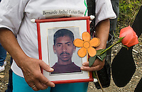 A woman shows a sign with a picture of her missing son in commemoration of the National Movement of Victims of State Crimes, MOVICE, commemorate this April 9 as the Day of Memory and Solidarity with Victims of state crimes in this time of vital importance to the country because it was from when triggered, significantly, the political conflict, social and armed, that today, after decades, continues in the form of persecution, threats and harassment against land claimants leaders and human rights defenders. In the district there are 13 mass graves containing more than 1000 dead buried in a dump that works in the area. The close calls that dump MOVISE and declare the area as a cemetery. In Colombia, this time away from a transitional or post. More than 60 leaders killed lands (at least 26 of these victims killed between 2010 and 2011), the reengineering of paramilitarism in over 400 municipalities, more than 1,400 displaced people killed since 2007, a development model based on dispossession and displacement.. In Medellín, Colombia. 09/04/2012. Photo by Fredy Amariles/VIEWpress.