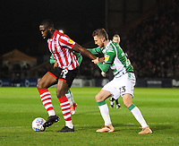 Lincoln City's John Akinde shields the ball from Yeovil Town's Tom James<br /> <br /> Photographer Andrew Vaughan/CameraSport<br /> <br /> The EFL Sky Bet League Two - Lincoln City v Yeovil Town - Friday 8th March 2019 - Sincil Bank - Lincoln<br /> <br /> World Copyright © 2019 CameraSport. All rights reserved. 43 Linden Ave. Countesthorpe. Leicester. England. LE8 5PG - Tel: +44 (0) 116 277 4147 - admin@camerasport.com - www.camerasport.com